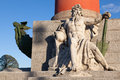 Statue of neptune with an oar and female figure on the bow in the rostral column in st petersburg Royalty Free Stock Photography
