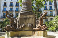 Statue of newts playing a horn, Barcelona Royalty Free Stock Photo