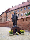Statue of pope john paul ii in krakow wawel castle in cracow poland Stock Photos