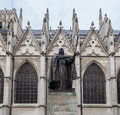 Statue priest side cathedral its gothic ogival windows gables brussels belgium Royalty Free Stock Images