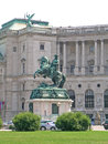 The statue of prince eugene of savoy is located in hofburg palace neue burg section seen from heldenplatz vienna austria Stock Photos