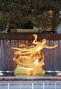Statue of Prometheus under Rockefeller Center Christmas Tree at the Lower Plaza of Rockefeller Center in Manhattan Royalty Free Stock Photo