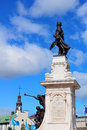 Statue in quebec city and historical buildings Royalty Free Stock Photo