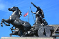 Statue of queen boudicca boudica with horses and chariot union jack on adjacent building london england united kingdom Royalty Free Stock Photo