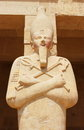 Statue of Queen Hatshepsut surrounding the main entrance of her temple in Luxor. Royalty Free Stock Photo