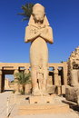 Statue of ramses with his daughter merit amen at karnak temple Stock Image