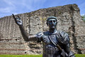 Statue of Roman Emperor Trajan and Remains of London Wall Royalty Free Stock Photo