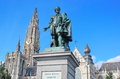 Statue of rubens in antwerpen belgium having the cathedral on the background a beautiful sunny day Stock Photography