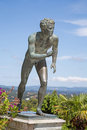 A statue of 'The Runner' in the garden of Achilleion in Corfu. Royalty Free Stock Photo