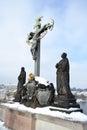 Statue Saint Cross in Charles bridge Stock Images