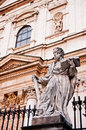 Statue of a saint in front of church in Krakow Stock Images