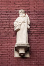 Statue of saint jacob on the walls a cathedral in amsterdam Stock Photo