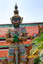 The statue with sword. Wat Pho Temple in Bangkok. Royalty Free Stock Photo