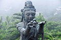 Statue in tian tan buddha complex neighboring shrouded fog Stock Photo