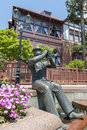 Statue of trumpet player in front of Weathercock House in historic area of Kitano district in Kobe, Japan Royalty Free Stock Photo
