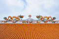 Statue of twin dragons on the roof chinese temple Royalty Free Stock Image