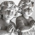 Statues of children in prayer Royalty Free Stock Photo