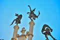 Statues of dancing figures on a roof in ghent belgium Stock Image
