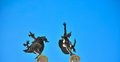 Statues of dancing figures on a roof in ghent belgium Stock Photography