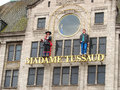 Statues on the facade of the museum madame tussauds in amsterdam netherlands february netherlands Royalty Free Stock Photo