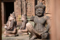 The statues guard of banteay srei temple entrance to an intricately carved angkor wat Stock Images