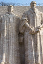 Statues of john calvin and william farel on the reformation wall in parc des bastions geneva switzerland photo taken on march Stock Photography