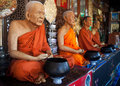 Statues of monks in bangkok thailand four buddhaist Royalty Free Stock Photography
