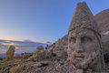 Statues on mount nemrut the most beautiful sunset in the world turkey Stock Photos
