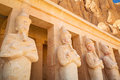Statues of queen hatshepsut in egypt the temple Stock Photos