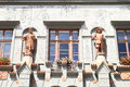 Statues on renaissance house windows with flowers and a in town prachatice czech republic Stock Images