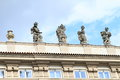 Statues on roof in prague czech republic covered with net against pigeons Stock Images
