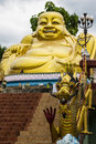 Statuette of hotei buddha and dragon in thailand chaina temple Stock Photos