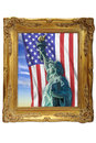 Stature of liberty statue in a golden picture frame Royalty Free Stock Photos