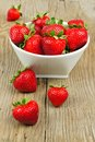 Stawberries on wood bowl full of juicy strawberries a background Royalty Free Stock Image
