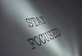 Stay focused light centred on the words motivational phrase Royalty Free Stock Image