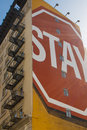 Stay sign painted on building saying in the street of san francisco california Stock Photos