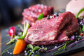 Steak.Beef steak.Meat.Portioned meat.Raw fresh meat.Sirloin steak.T-Bone steak. Flank steak. Duck breast. Vegetable decoration. Royalty Free Stock Photo