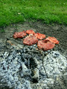 Steak cooking over fire Royalty Free Stock Photo