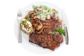 Steak dinner grilled beef t bone with caesar salad mushrooms and rosemary Stock Photo
