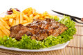 Steak with french fries and dip Royalty Free Stock Image
