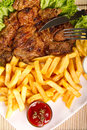 Steak with french fries and dip Royalty Free Stock Photography