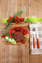 Steak garnished with green staff bbq beef pork and red chili hot pepper on wooden table cutlery Stock Photo