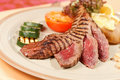 Steak with grilled vegetables Stock Images