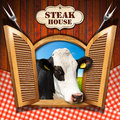 Steak House - Window with Cow Royalty Free Stock Photo