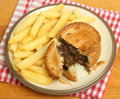 Steak kidney pie chips or fries with Royalty Free Stock Photos