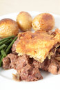 Steak and kidney pie vertical Royalty Free Stock Photo