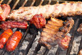 Steak and other meat on bbq ready to eat Royalty Free Stock Photo