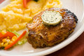 Steak of pork,grilled-with salad of potatoes Royalty Free Stock Images