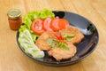 Steak pork with vegetables on table Stock Photos