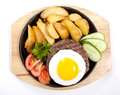 Steak with potato and egg Stock Photos